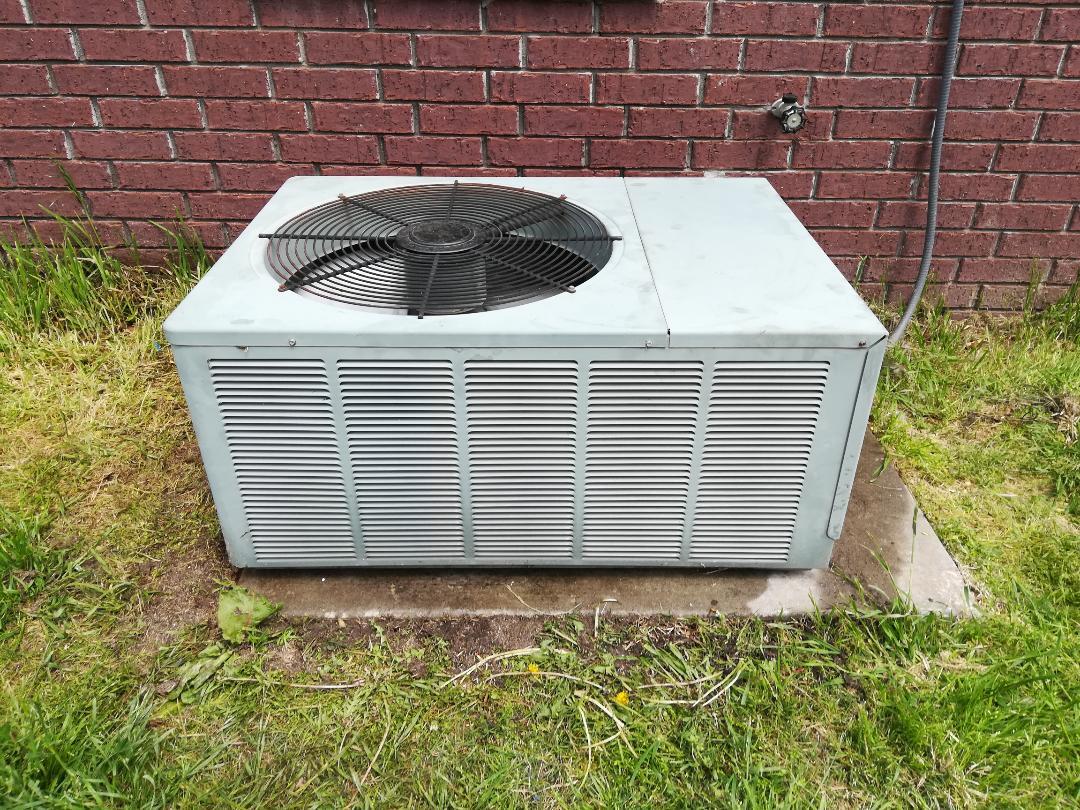 Bentonville, AR - Doing preventative maintenance on an air conditioner