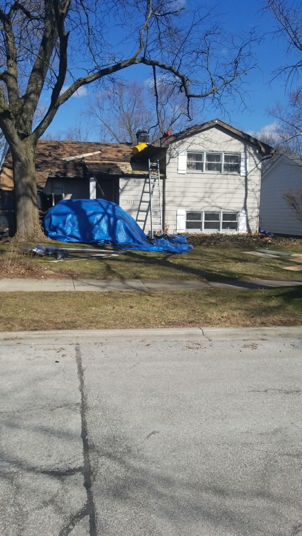 Homewood, IL - At the home of Huphfer where they are installing new roof and siding which was approved by State Farm insurance because of damages due to wind and hail storms