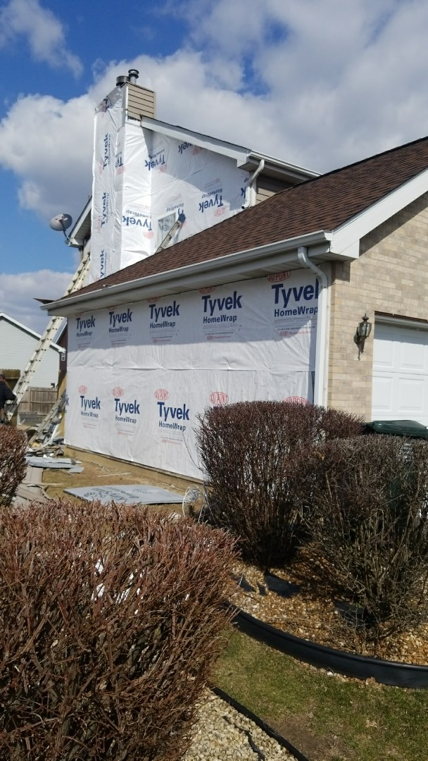 Country Club Hills, IL - At the Sanders residence in Country Club Hill where they were approved through All State insurance for replacement of all siding because of hail and wind damage