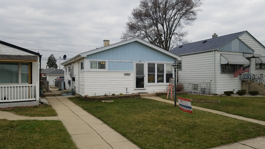 River Grove, IL - Another homeowner who we helped along with State Farm. House and garage..