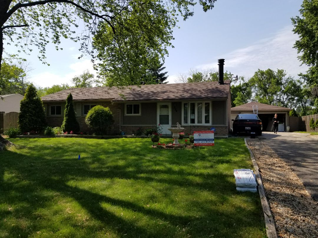 Bolingbrook, IL - Just install GAF Hickory shingles on this home in Bolingbrook. Roof paid for in full by Allstate, making a difference in this storm damage neighborhood one home at a time!