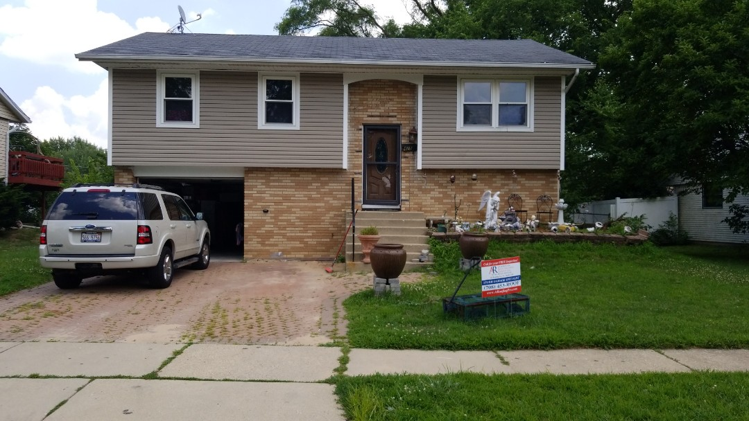 Streamwood, IL - ARGI and Am-Fam just made this family very HAPPY.. New roof, gutters, and down spouts