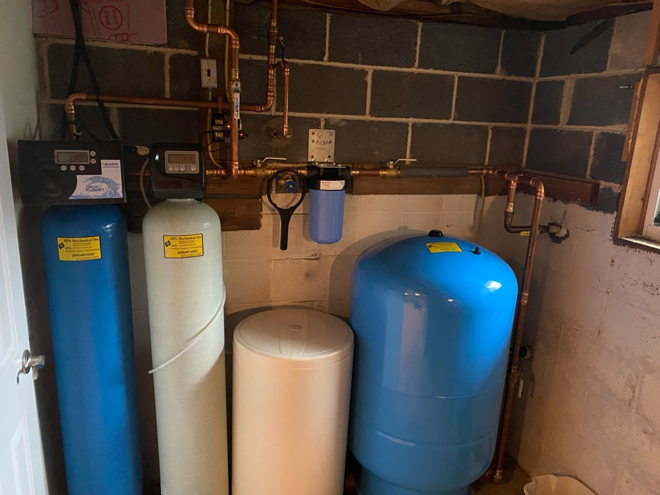 Washington Township, NJ - Installed water treatment system, 50 gallon electric HWH, point of use faucet with carbon filter and 80 gallon well tank with repiping for Geothermal system with 50 micron filter
