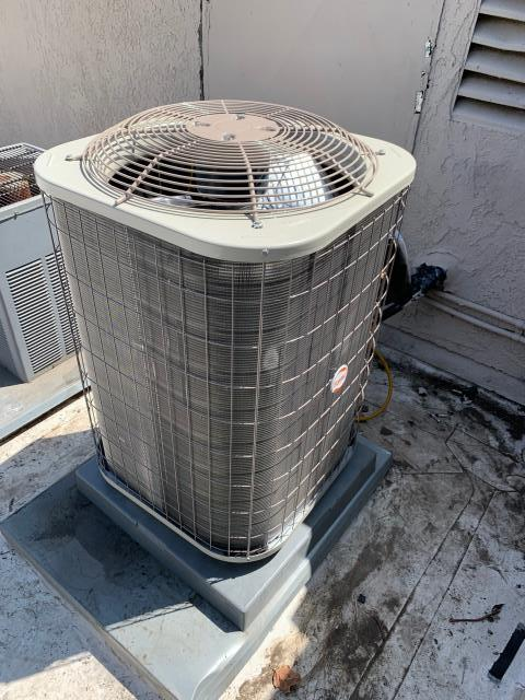Fullerton, CA - Replace old fan and heat pump condenser with new Carrier system.