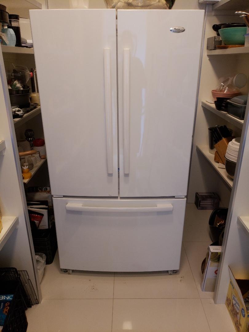 Phoenix, AZ - Whirlpool french door bottom freezer, fridge compartment warm but freezer is cold.