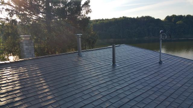 Senecaville, OH - A new Matterhorn metal roofing system was installed on this lake house.  The previous roof would have constant algae issues due to the moist air around the lake, so this metal system was a much better fit to prevent such issues.