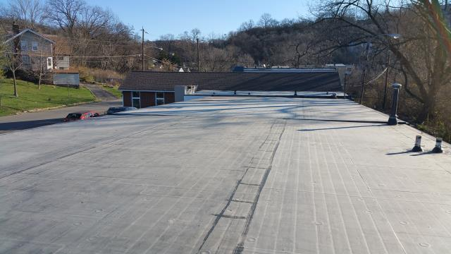Cincinnati, OH - Commercial flat, rubber roof replacement due to leaking which caused the fiber board below to become saturated.  The new EPDM roof was installed over a new tapered ISO board system, allowing for proper drainage.  The asphalt roof over the congregation area was replaced with a new GAF lifetime roofing system.