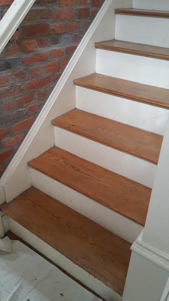 Columbus, OH - Custom wood stair rebuild in an early 1900s home in German Village due to sagging in the structure of the stairs.  All wood was refinished to remain original and the interior portion of the stair structure was replaced.