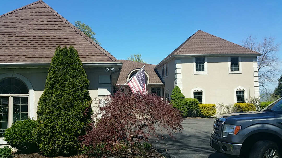 Avon Lake, OH - Roof inspection for missing shingles due to wind damage.