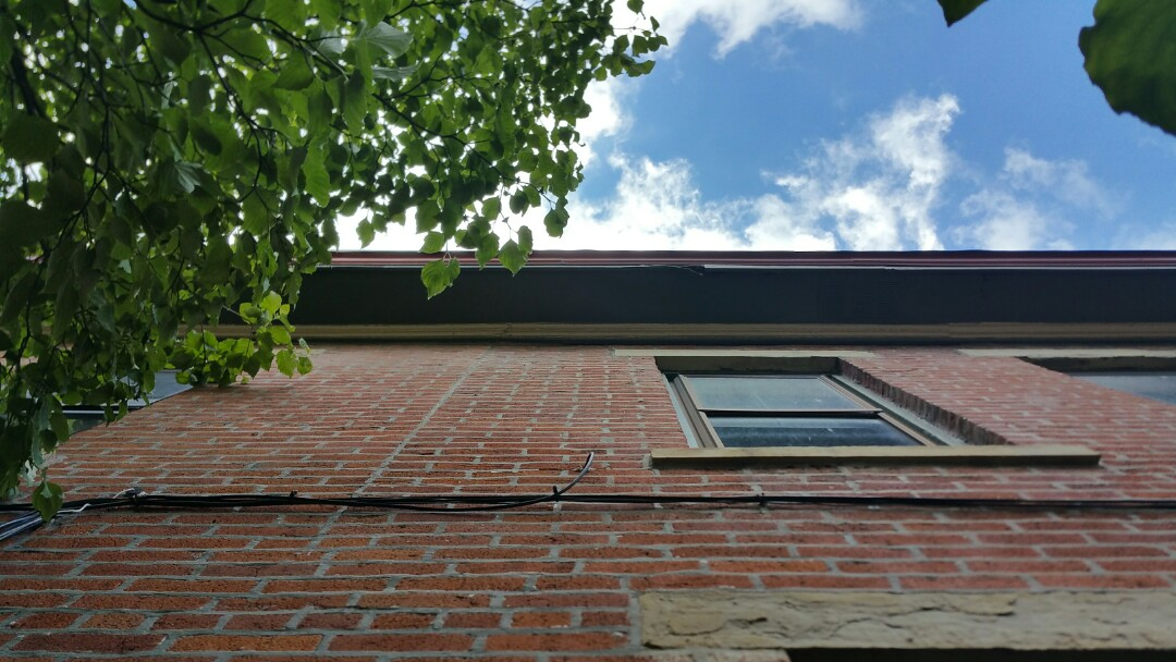 Columbus, OH - Inspection for rotten wood behind box gutters in Victorian Village.