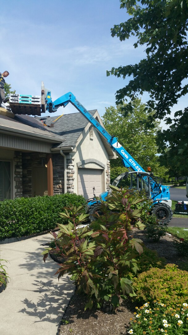 Springdale, OH - Shingle loading on this full commercial roofing replacement.