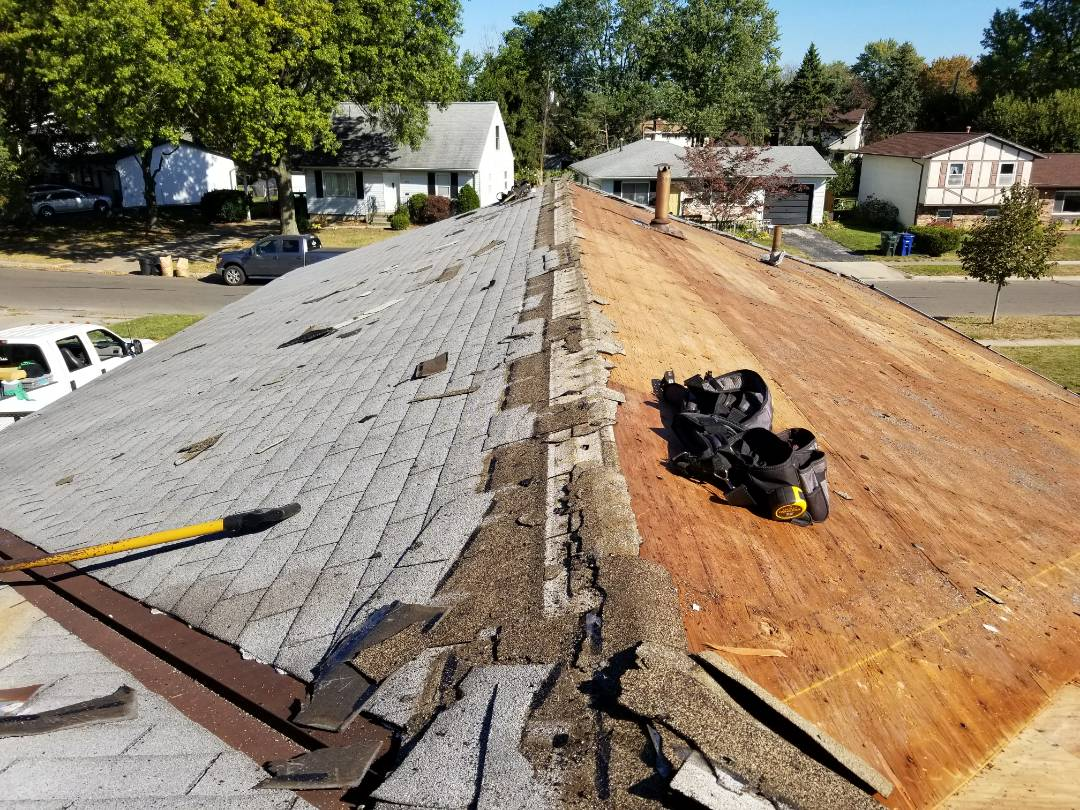 Columbus, OH - Full roof replacement in Columbus due to wind damage, paid in full by the insurance company.