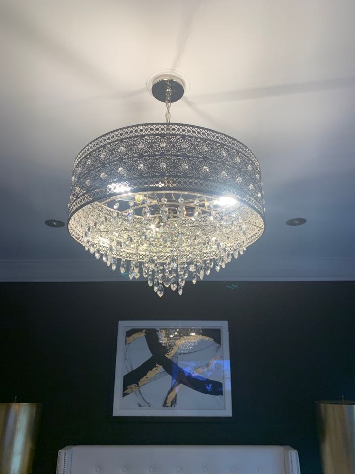 Glen Burnie, MD - Took down an old light fixture and replaced it with a small chandelier with crystals in Glen Burnie, MD