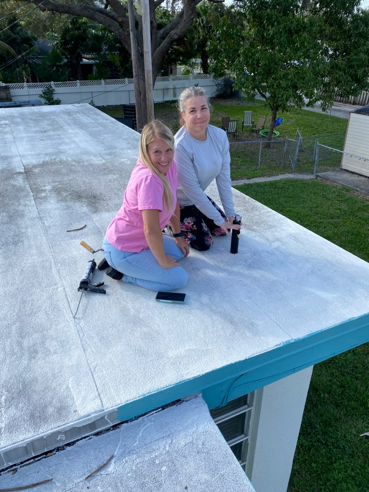 Hollywood, FL - Taking a core sample to determine the layers of the flat roof for accuracy.