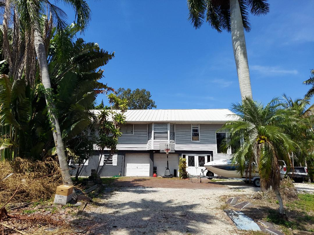 Fort Myers, FL - Insurance approved replacement after adjuster met with Ted-We Upgraded from Shingle to Standing Seam White Metal. Let A Crown do a free no obligation roof inspection analysis to see if your shingles qualify you for a free replacement. TED Z 239 246 7676 -  A+ Work for Lee and Collier Counties