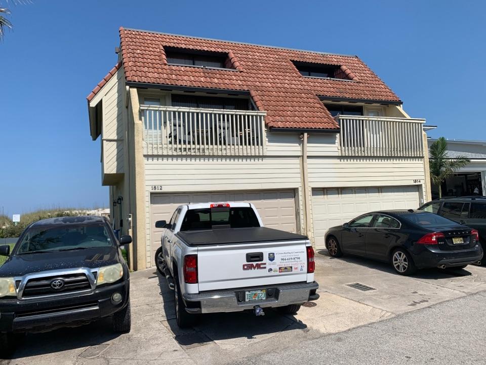 Neptune Beach, FL - Replace flat roof and repair bad window trim.