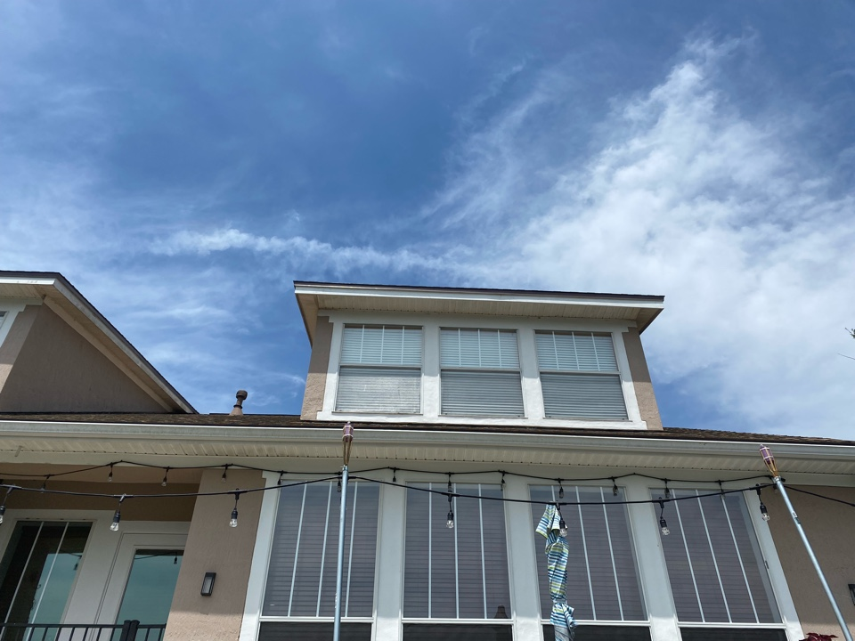 Saint Johns, FL - Another St Johns Golf and Country Facia Job. Builder used a pressboard that absorbs water and rots.  We replaced with real wood and painted.  Call Jon @904-349-8082