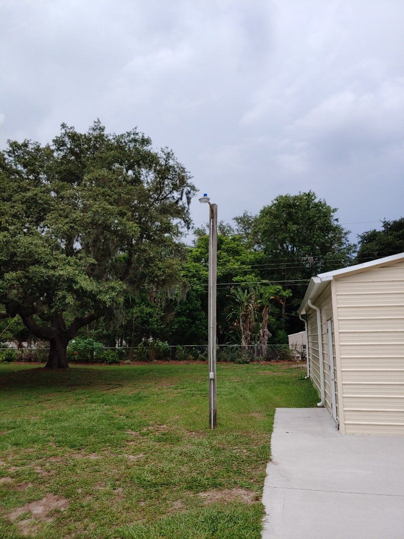 Installed new LED lamp on yard pole.