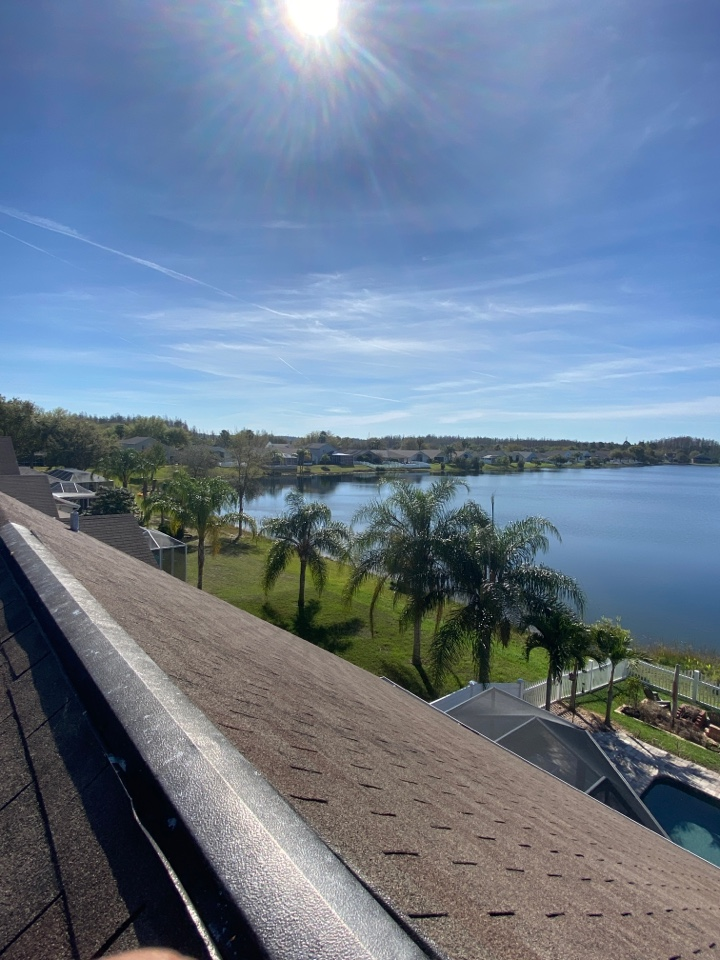 Land O' Lakes, FL - On top of a steep shingle roof in Land O Lakes. Looking for new duration architectural shingles by Owens Corning. Full re-roof