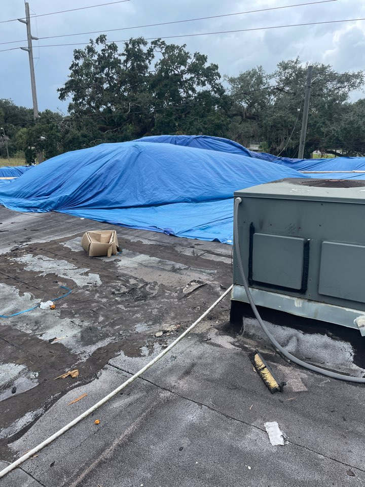 Tampa, FL - Inspecting damages and taking measurements for a church