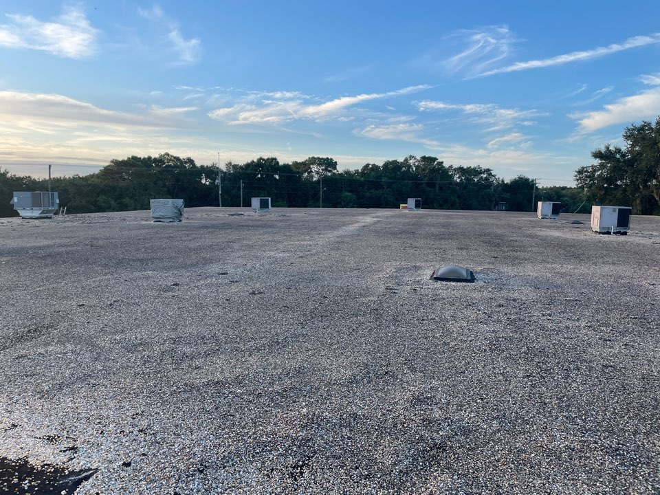 Tampa, FL - Inspecting gravel roof