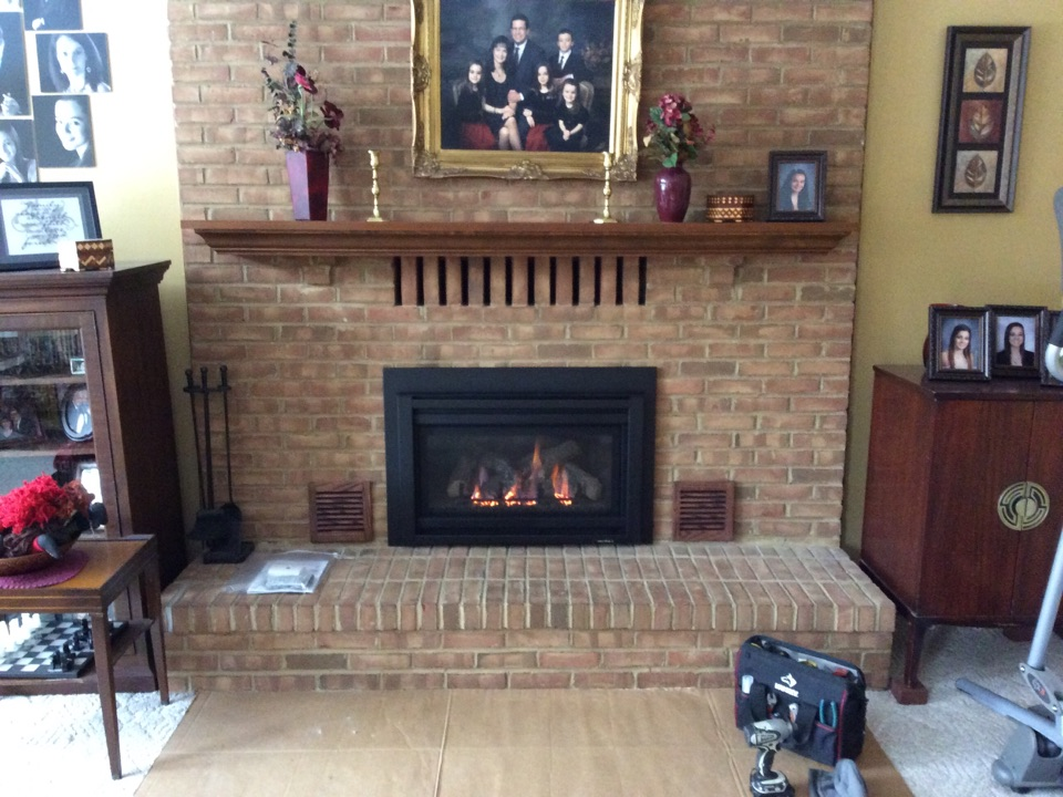 Installing a gas insert in the masonry fireplace