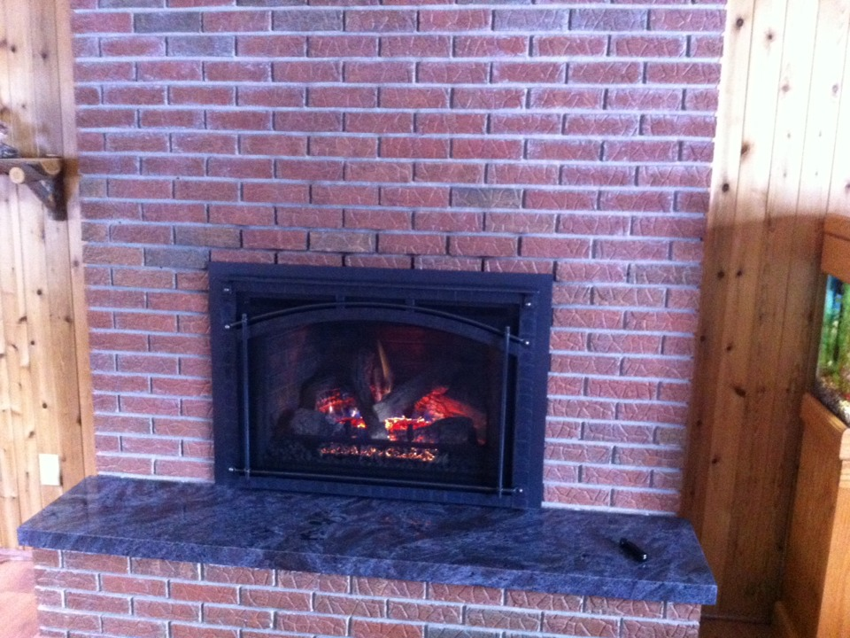 Clio, MI - Replaced the gas insert fireplace