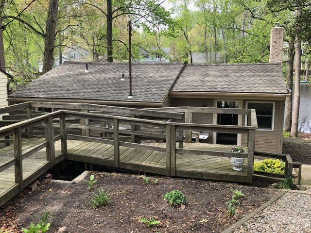 Elk, NJ - New GAF Timberline Weathered Wood roofing installation in this natural setting.