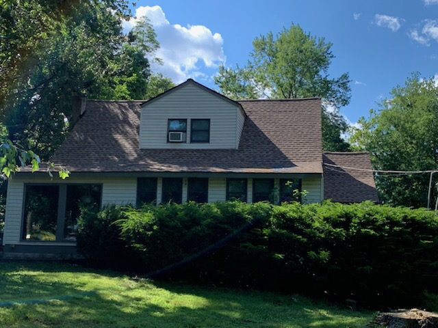 , NJ - Roofing repair to the front elevation of this home using GAF Timberline Shakewood shingles.