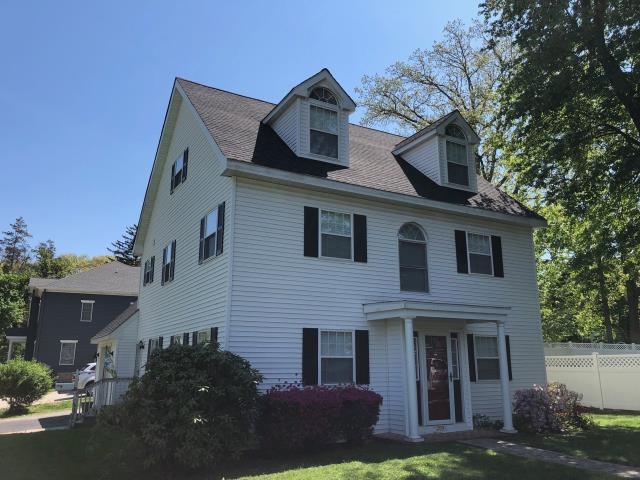 Pitman, NJ - Installation of new GAF Timberline Charcoal roof on this colonial with classic black and white color scheme.