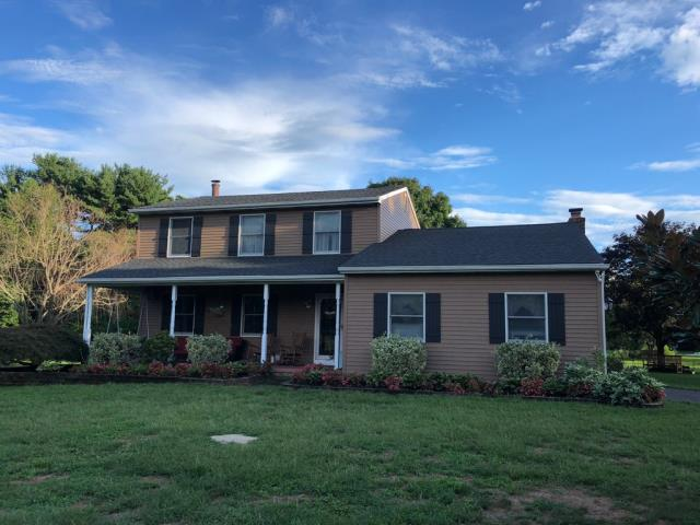 Mullica Hill, NJ - Completed roof installation using GAF Timberline Charcoal shingles.