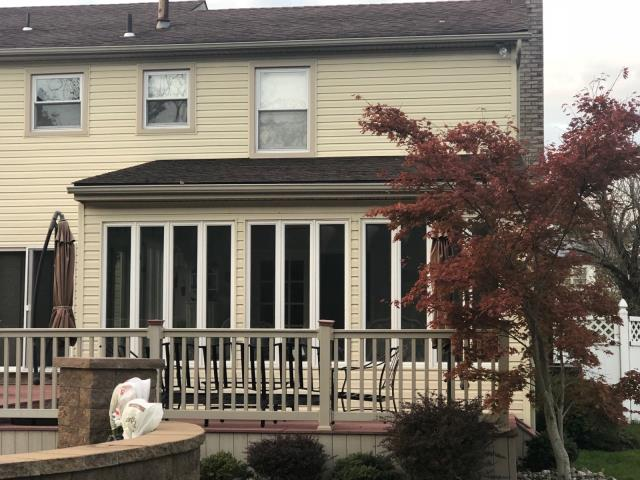 Washington Township, NJ - Sunroom roof replacement using GAF Timberline Hickory shingles.