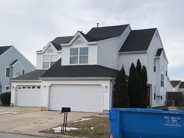 Washington Township, NJ - Complete new roof installation using GAF Timberline Charcoal shingles.