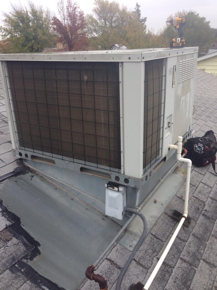 Orangevale, CA - Maintenance on package unit on roof.