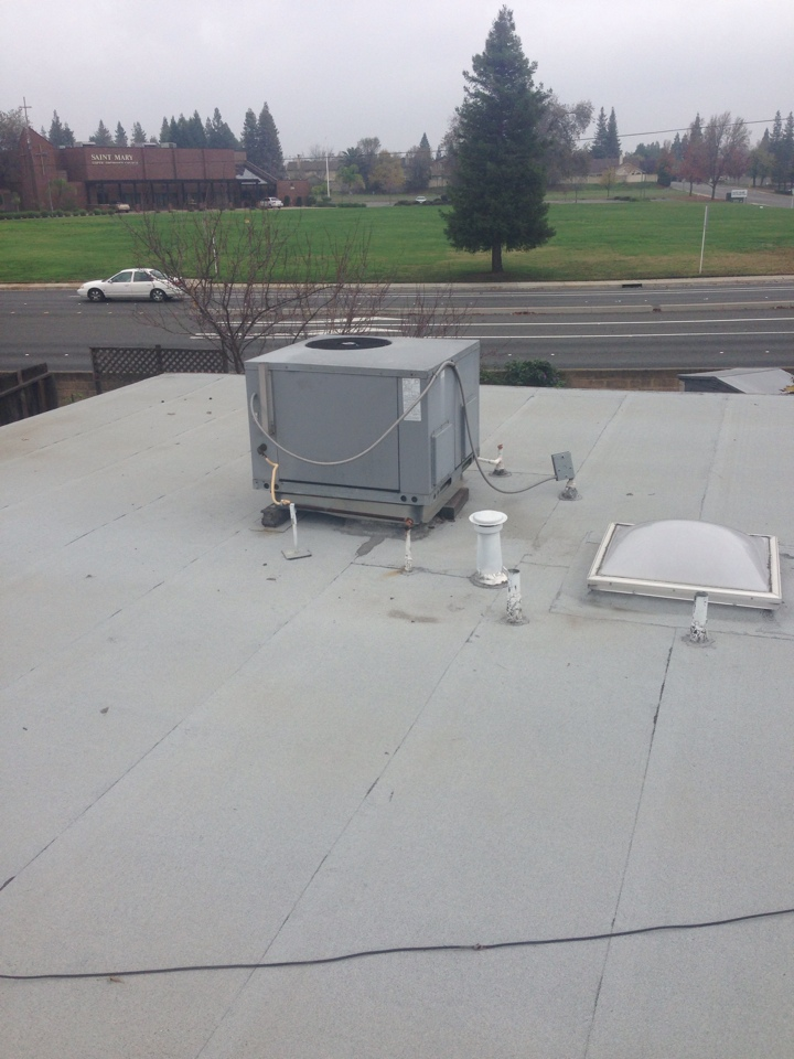 Roseville, CA - Maintenance on roof package unit made by Heil.