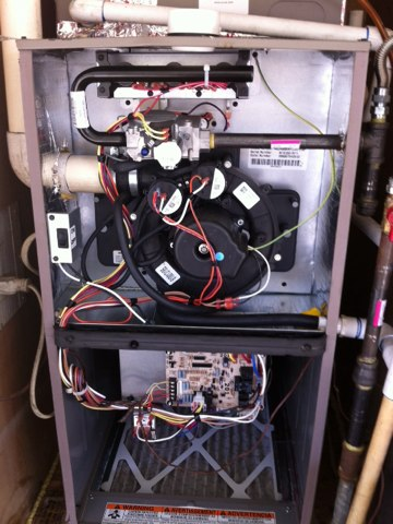 Newcastle, CA - Performing a rejuvenation on a split furnace system.