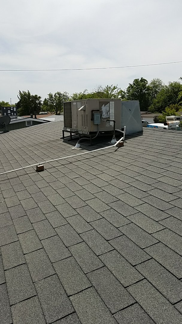 Sacramento, CA - In sacramento doing a 241 rejuvenation on a 21 year old york package unit on the roof.