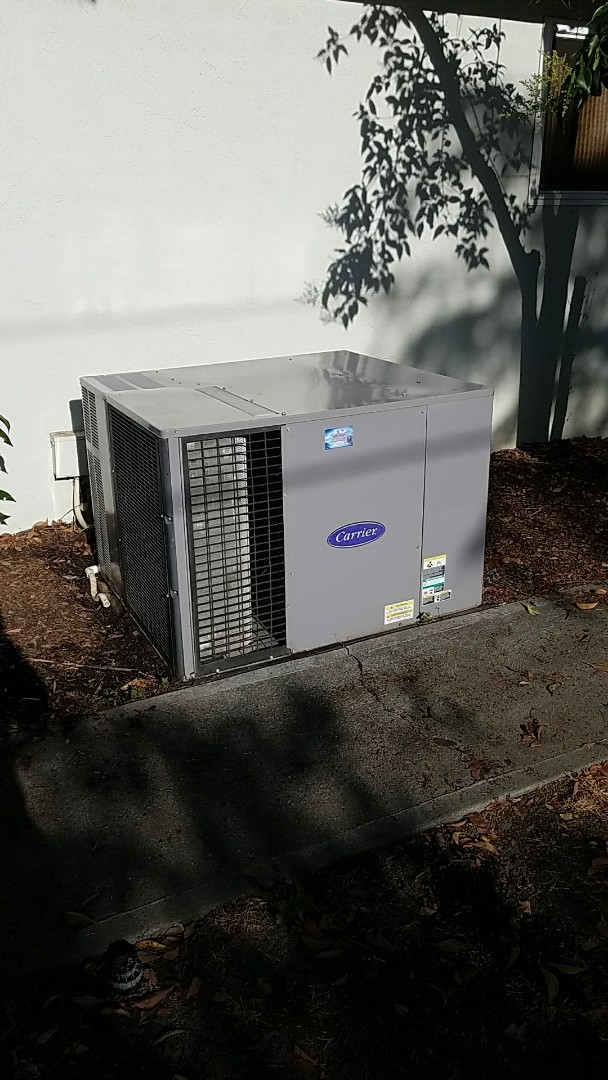 Woodland, CA - Ac rejuvenation on a 19 year old carrier package unit on the ground.