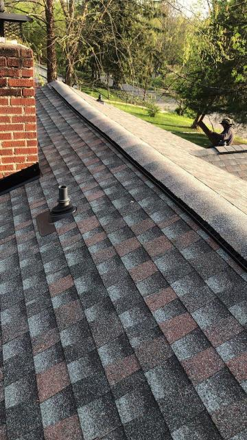 Asheville, NC - Completed Golden Pledge installation by Balken Roofing. Shingle Roof color - Williamsburg Slate.  Easy financing with a variety of payment options available.