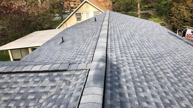 Hendersonville, NC - Completed Golden Pledge installation by Balken Roofing. Shingle Roof color - Biscayne Blue. Easy financing with a variety of payment options.