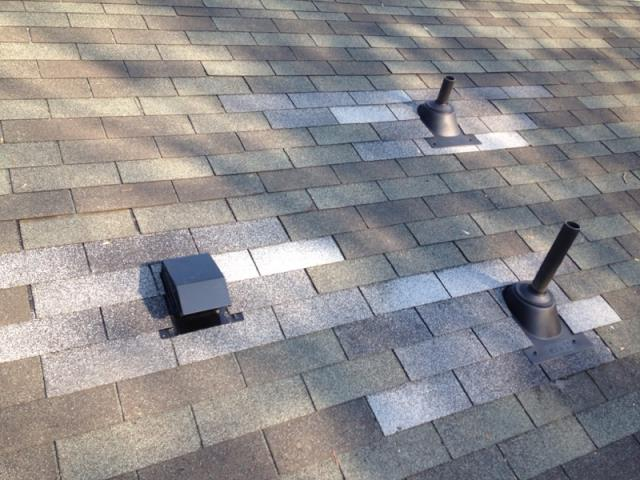 Hendersonville, NC - Balken Roofing repaired pipe boots and a bathroom vent on shingle roof. Don't they look sharp?