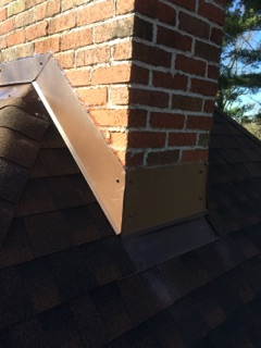 Asheville, NC - Repaired/replaced several pipe boots and reflashed 1 brick chimney.