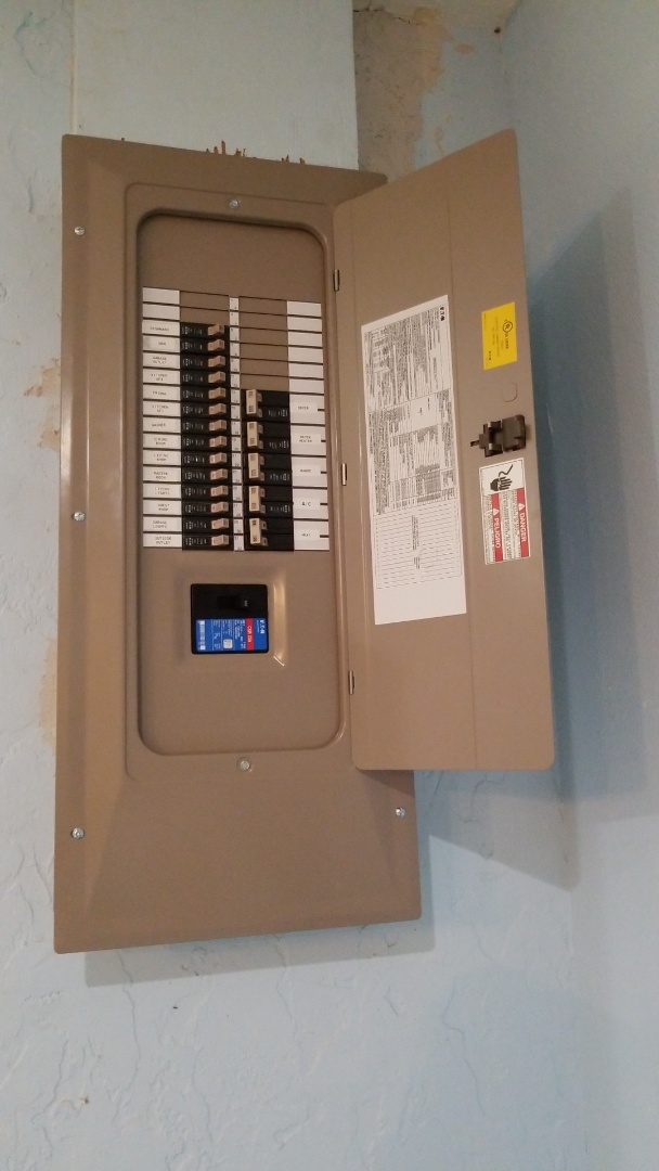 New 200 amp main breaker panel in Port Charlotte with new meter can, riser, and grounding