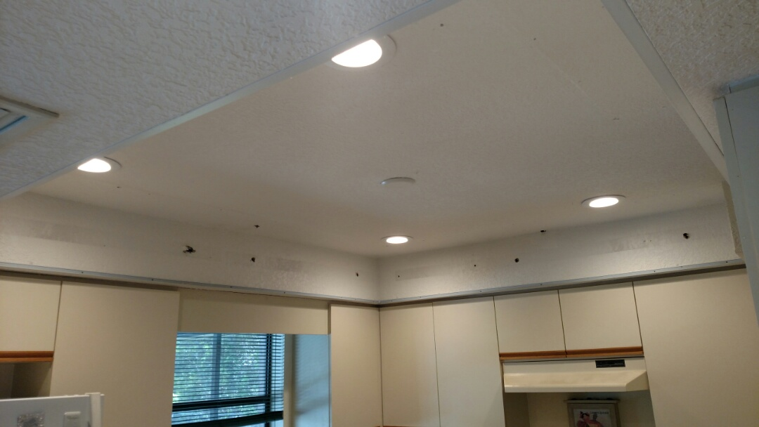 Englewood, FL - Removed fluorescent fixtures in kitchen and installed 4 LED recessed cans. Also installed ceiling fan on Lanai