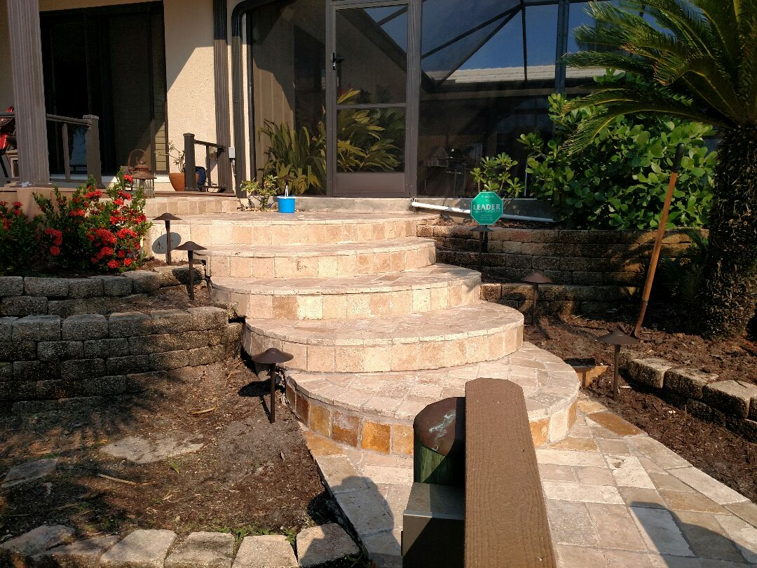 Nokomis, FL - Installed LED landscape lighting up steps from boat dock and on dock. Also hung two fixtures and installed ceiling fixture on lanai