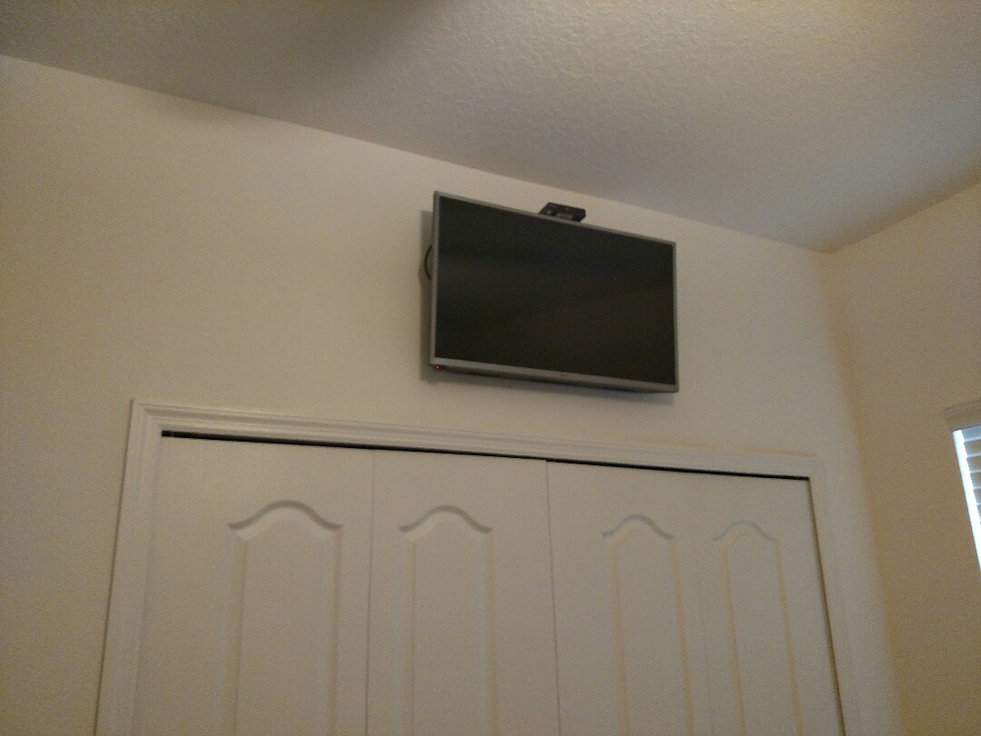 Port Charlotte, FL - Installed outlet and cable line and mounted tv