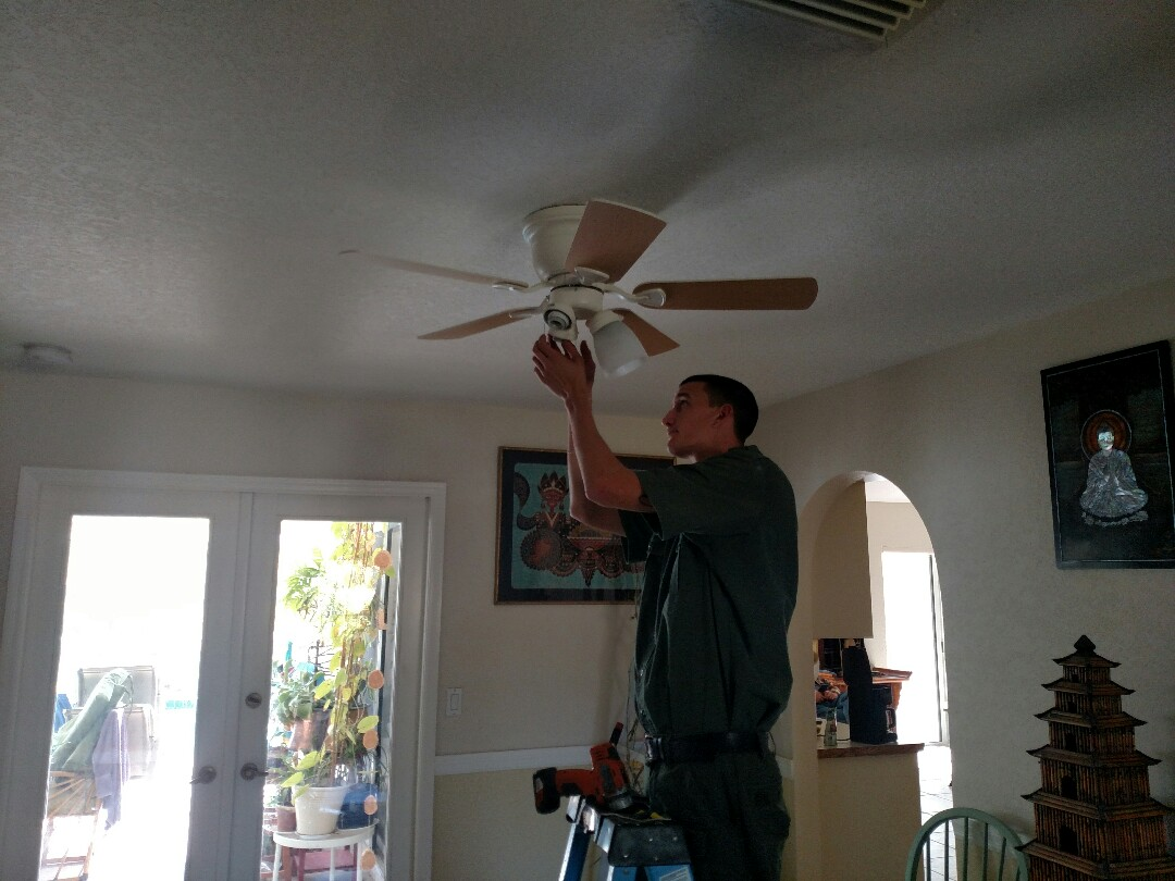 Port Charlotte, FL - Removed dining room chandelier, installed proper steel fan rated box, and than installed ceiling fan