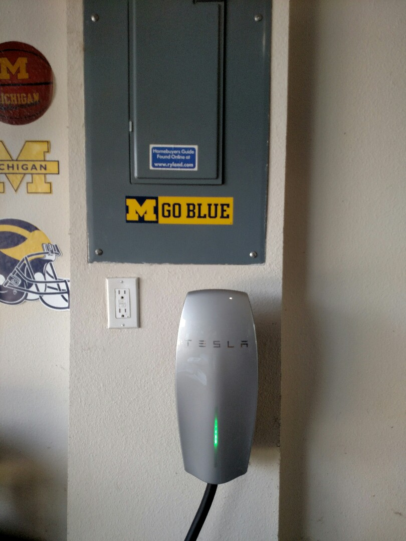 Parrish, FL - Installed tesla charger, generatot inlet for portable generator and whole house surge protector.