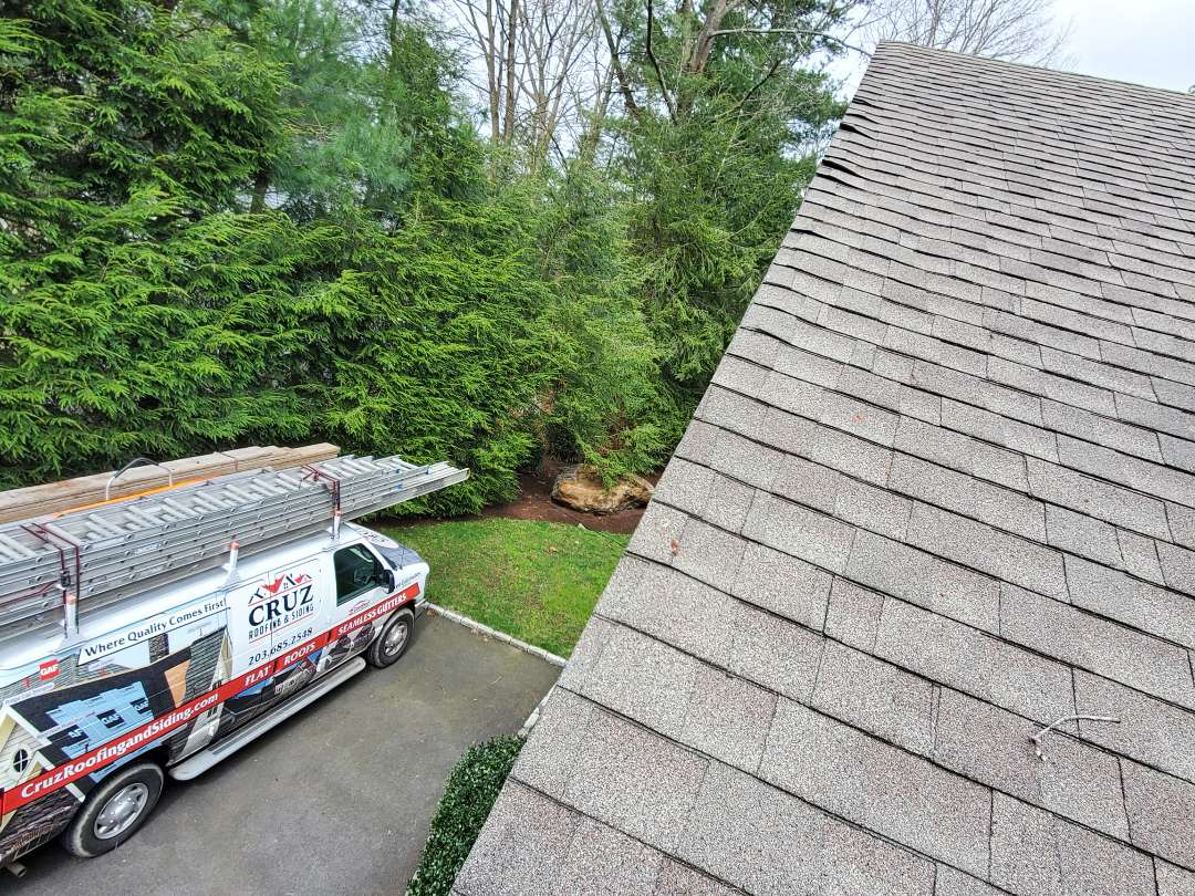Westport, CT - Roof leak inspection, we found multiple spots with wind damaged and siding problems as well.