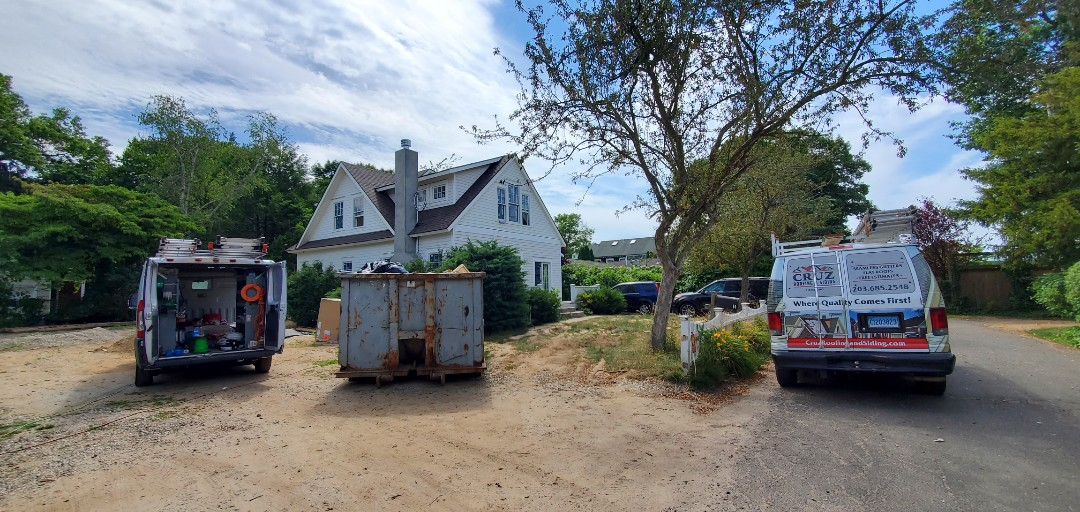 Greenwich, CT - Roof replacement, We INSTALLED  a Owen's Corning roof system  in color Teakwood.